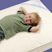 Niño en colchón